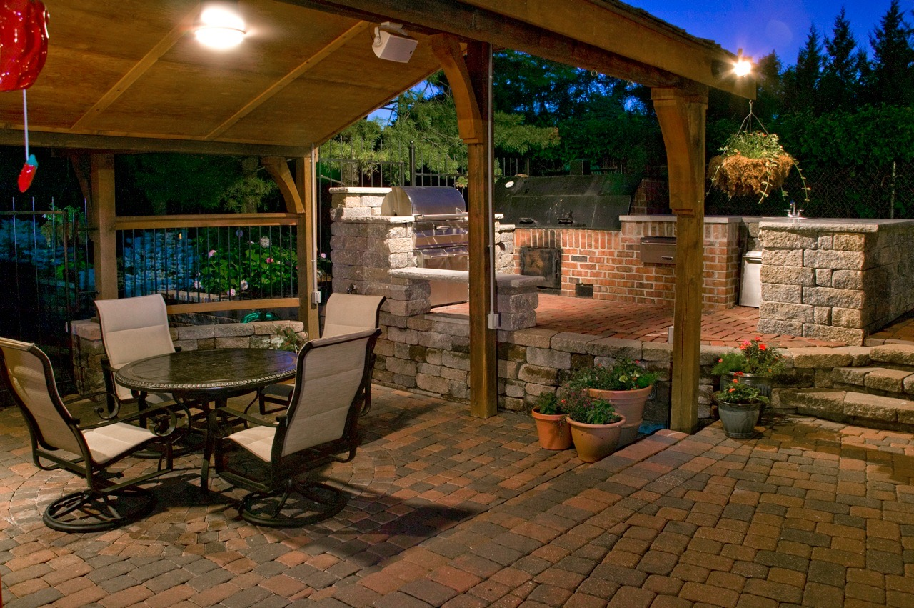 The Robertsu0027 Garden Is Really A Backyard Made For Fun! There Is A Large  Swimming Pool, Deck, Covered Patio, And Outdoor Fireplace. The Cooking Area  Includes ...